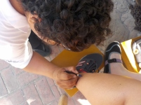 getting a henna tattoo for our next clue