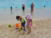 playing with toys on beach